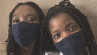 Mother and daughter in Cape Town wearing masks
