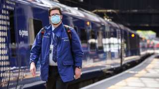 ScotRail worker and train