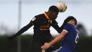 Tyreeq Bakinson of Newport County fouls Louis Birch of Metropolitan Police
