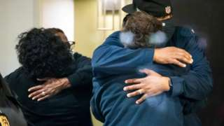 People embrace after shootings at the FedEx facility in Indianapolis, Indiana,