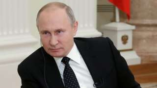Russian President Vladimir Putin listens during an interview with the Financial Times