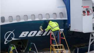 Worker on Boeing aircraft