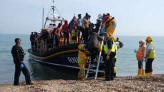 A boat of migrants arriving in Kent