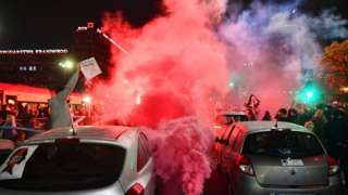 Protesters block a street in the city centre during a protest against the tightening of the abortion law in Warsaw, Poland