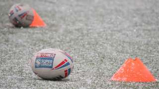 Leeds Rhinos training shot of balls in the snow