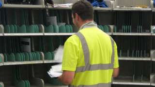 Guernsey postman sorting letters