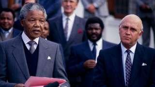 Nelson Mandela and FW de Klerk address a joint press conference