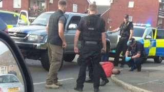 Still of mobile-phone footage showing Dan Sullivan's arrest