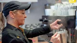 Woman working as barista