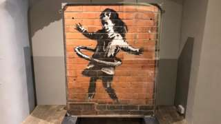 The installation of Banksy's hula-hooping girl at the Moyse's Hall Museum in Bury St Edmunds