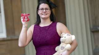 Melissa Mead with medal and teddy