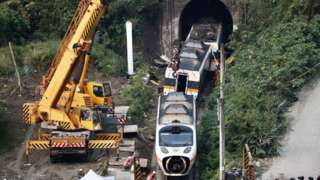 Salvage crews remove train carriages north of Hualien, Taiwan, 3 April 2021,