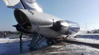 The aircraft stands on a road after leaving the runway at Mahshahr airport