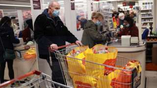 Shoppers in a Sainsbury's store