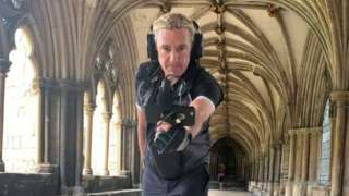 Paul records in Norwich Cathedral cloisters