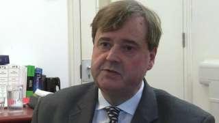 Judge Simon Carr