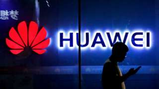 A man walks past a Huawei store in Beijing