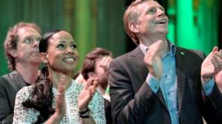 Swedish Green Party candidate Alice Bah Kuhnke (C) and Per Bolund await results