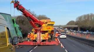 Lorry being recovered from ditch