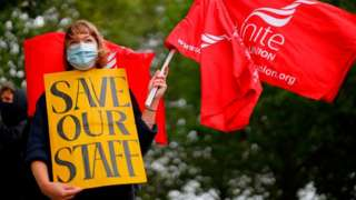 Unite union protester demonstrating against staff cuts at the National Theatre in London