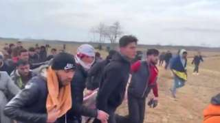 A group of men carried the man in a blanket away from the border and Turkey said he died later in hospital