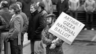 "A Leicester miner from the Power Group holds a placard addressed to National Union of Miners President Arthur Scargil, outside the NUM""s Sheffield headquarters when Scargill spoke to the Leicester miners."