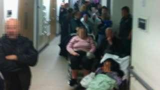 Pixelated image of a queue at the Cramlington hospital