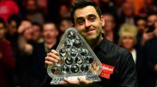 Ronnie O'Sullivan celebrates with Masters trophy