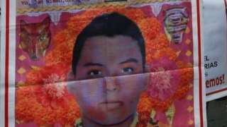 A relative of a missing student holds a poster with the image of Christian Alfonso Rodriguez Telumbre, as she takes part during a march to mark the disappearance of the 43 missing Ayotzinapa College Raul Isidro Burgos students in the state of Guerrero, along the streets in Mexico City, Mexico, September 26, 2018
