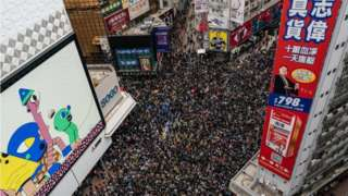 An aerial shot shows thousands of protesters filling a street for a rally on New Year's Day in Hong Kong