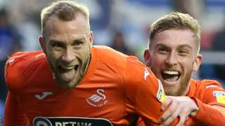Mike van der Hoorn and Oli McBurnie celebrate