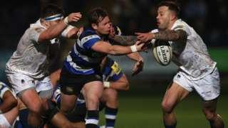 Bath scrum-half Chris Cook offloads under pressure from Worcester's Francois Hougaard