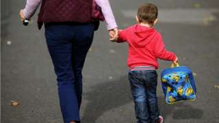 Woman and child walking away