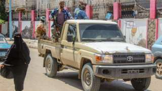 Fighters from the separatist Southern Transitional Council (STC) patrol the streets of Aden, Yemen, on 26 April 2020