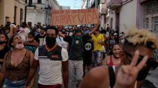 People shout slogans against the government during a protest against and in support of the government, amidst the coronavirus disease (COVID-19) outbreak, in Havana, Cuba July 11, 2021