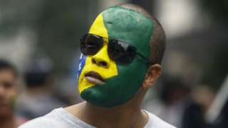 A supporter of Brazilian right-wing presidential candidate Jair Bolsonaro takes part in a rally along Paulista Avenue