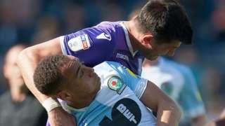 Danny Batth of Stoke City and Elliott Bennett of Blackburn Rovers in action