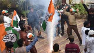 Congress-JMM alliance workers celebrate results projecting an assembly majority in the Jharkhand state election in Ranchi on December 23, 2019