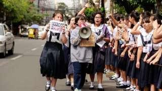 Schoolgirls protesting