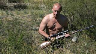 Putin carrying a sniper rifle while hunting topless