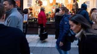 People walk in central Stockholm, Sweden. File photo