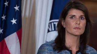 US envoy to the UN Nikki Haley standing in front of a US flag