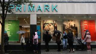 Shoppers queue outside Liverpool's Primark store