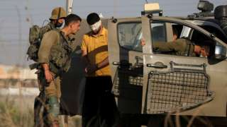Israeli troops detain a man near the northern Israeli village of Muqeibla while searching for six Palestinian prisoners who escaped Gilboa jail (6 September 2021)