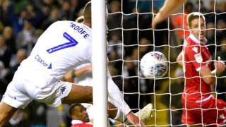 Kemar Roofe scores for Leeds with his arm