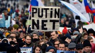 "A protester holds a placard reading ""Putin - No!"" during an opposition rally in central Moscow, on 10 March"
