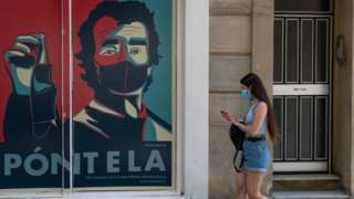Mask-wearing banner in Barcelona