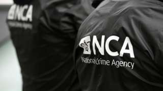 Stock image of a NCA logo on officers' jackets