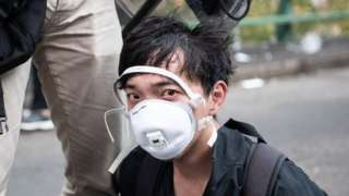"""HONG KONG, CHINA - NOVEMBER 18: Police arrest anti-government protesters at Hong Kong Polytechnic University on November 18, 2019 in Hong Kong, China. Anti-government protesters armed with bricks, firebombs, and bows and arrows fought with the police at university campuses over the weekend as demonstrations in Hong Kong stretched into its sixth month with demands for an independent inquiry into police brutality, the retraction of the word """"riot"""" to describe the rallies, and genuine universal suffrage. (Photo by Laurel Chor/Getty Images)"""