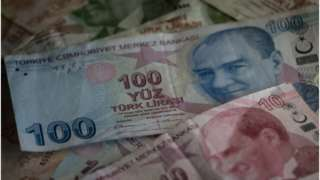 Turkey's currency tumbled as much as 14%.